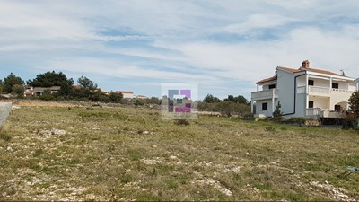 Large south-facing building plot with sea views